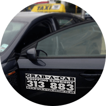 Black Grab a Cab taxi